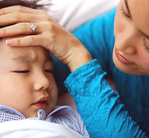 Mother with Hand on Boy's Forehead